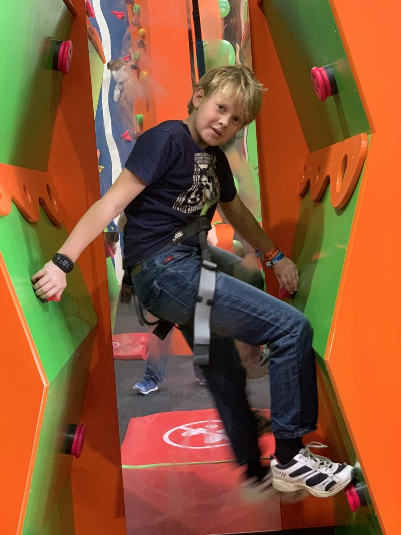 Boy on climbing wall at Mad Monkey Montpellier