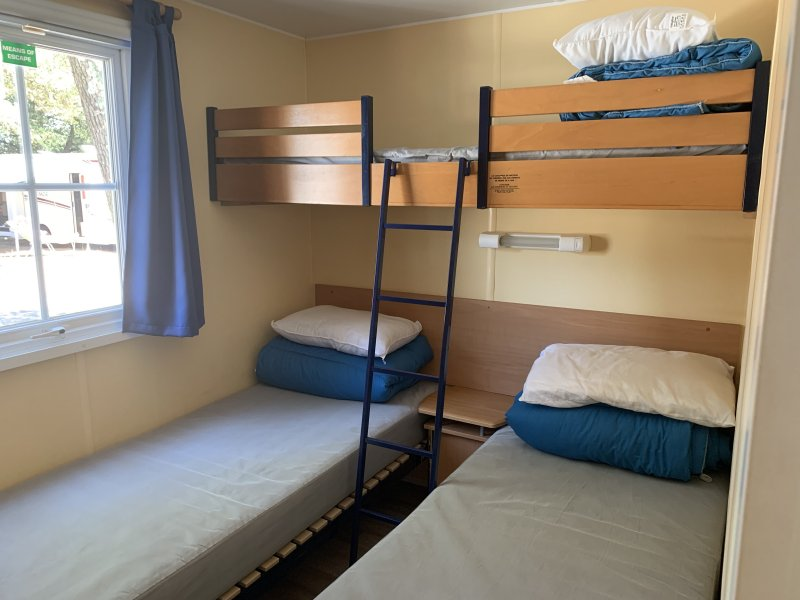 3 single beds at Camping Les Genêts with Eurocamp on a sun holiday
