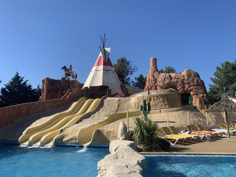 tee pee and slides - outdoor pool at camping les Genêts France