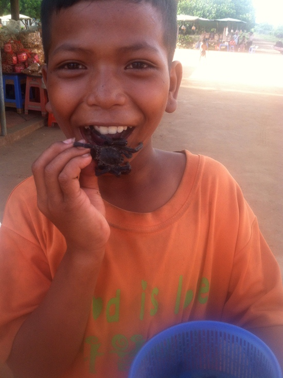 child eating in cambodia