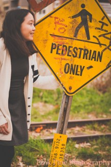 Jessica and railroad sign