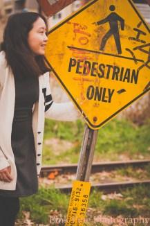 Jessica and railroad sign