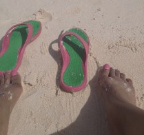 flip flops and feet on the beach