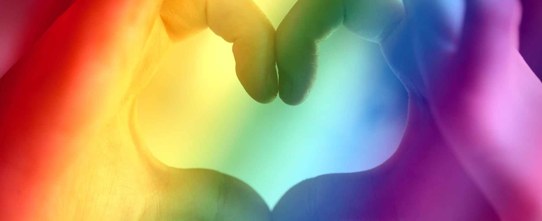 person s hand forming heart