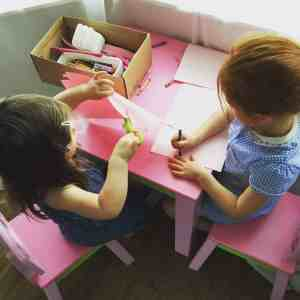 Preschoolers getting stuck in to the art supplies