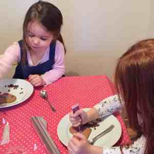 Thea and Ava decorating their biscuits.