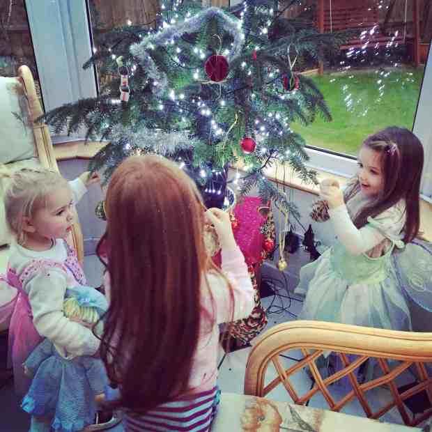 Bonnie, Ava and Thea decorating the Christmas tree
