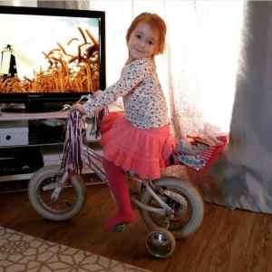 Ava on her bike