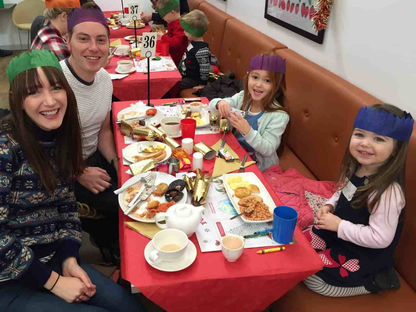 Christmas planning : The Pink family enjoying Breakfast with Santa
