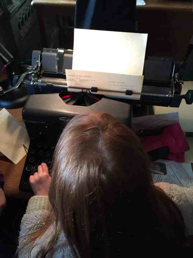 Ava trying a typewriter at Upton House