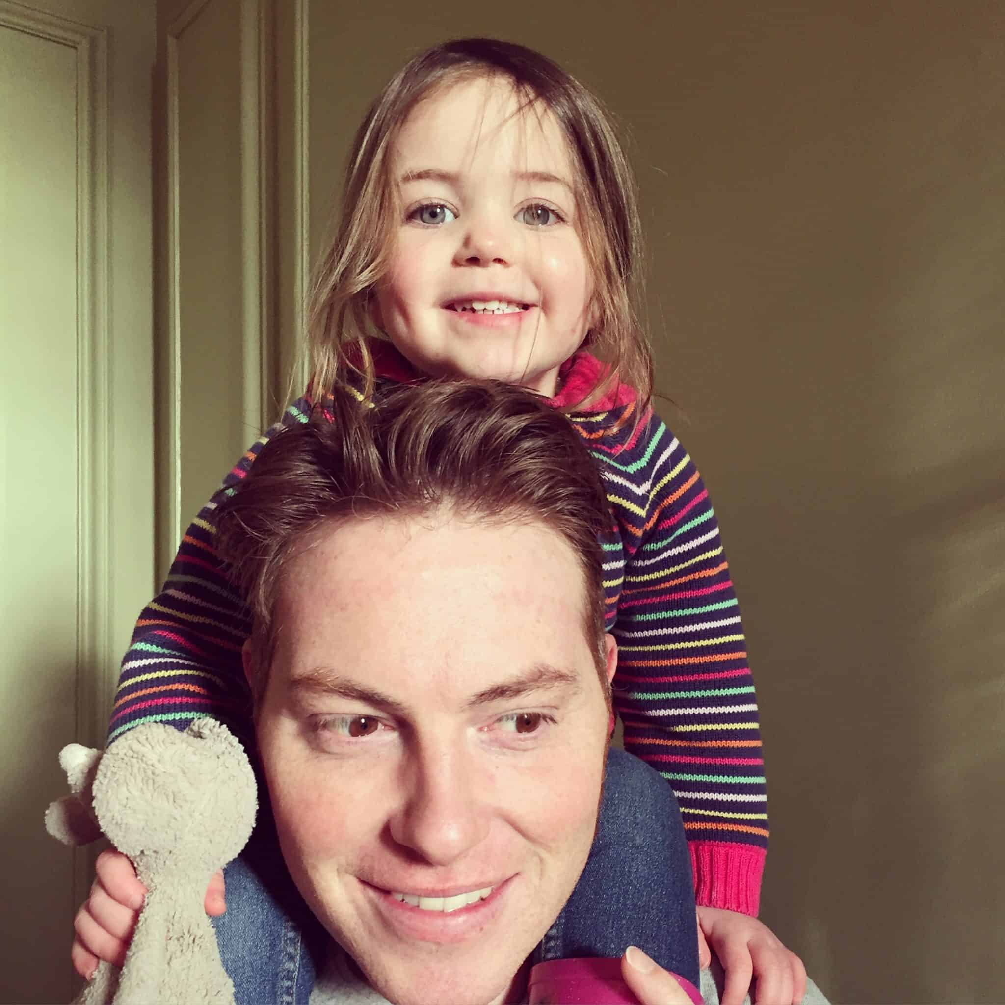 Thea on Ryan's shoulders