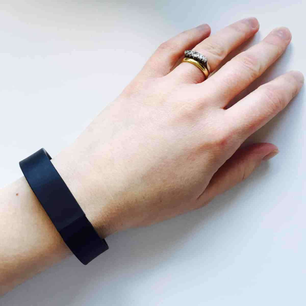 Becky's hand with a FitBit