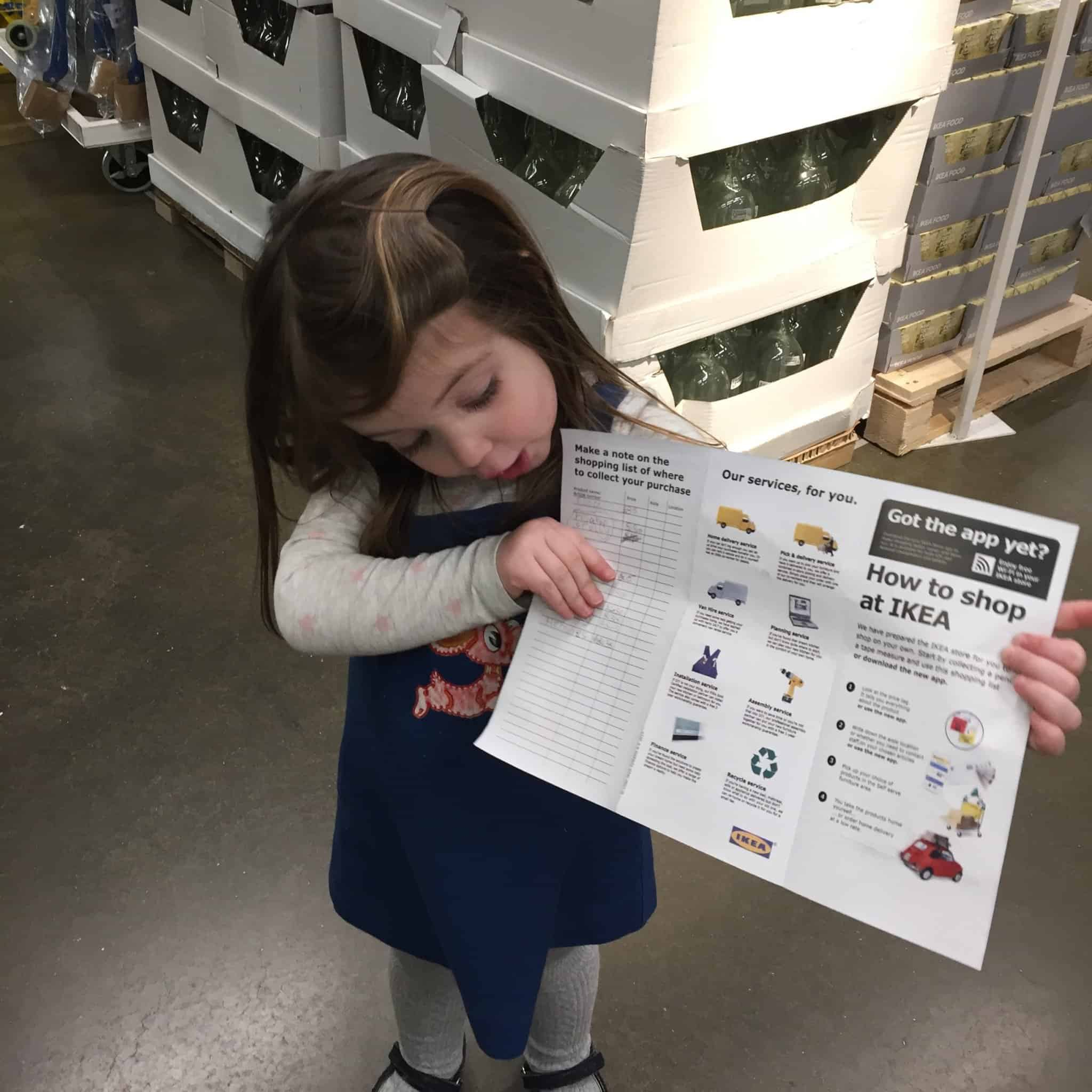Thea showing off her IKEA shopping list