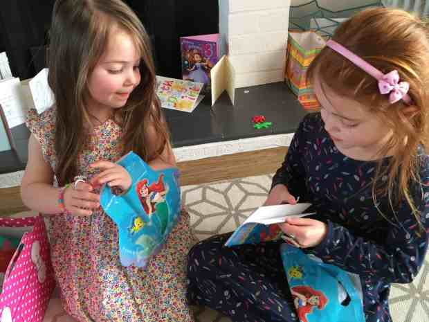 Thea and Ava opening their party bags from Party Bags & Supplies