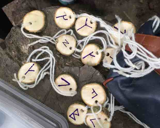 Wooden necklaces with runes