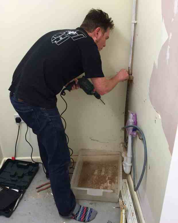 Ryan working on the utility room makeover