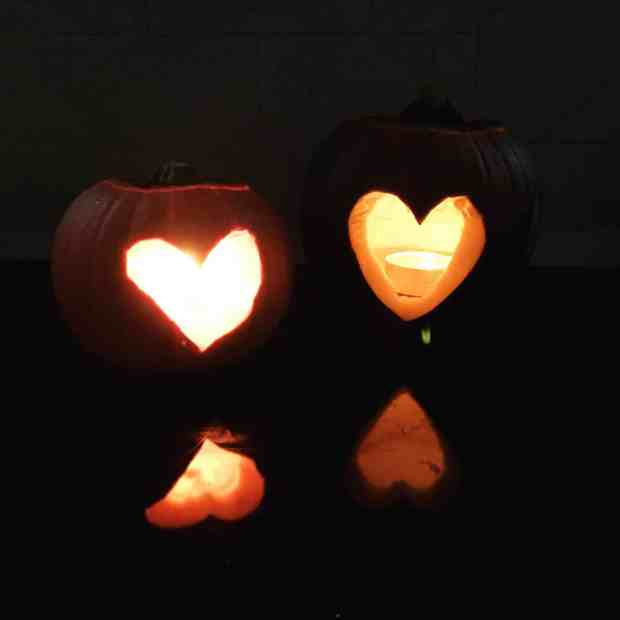 Pumpkins carved with a heart