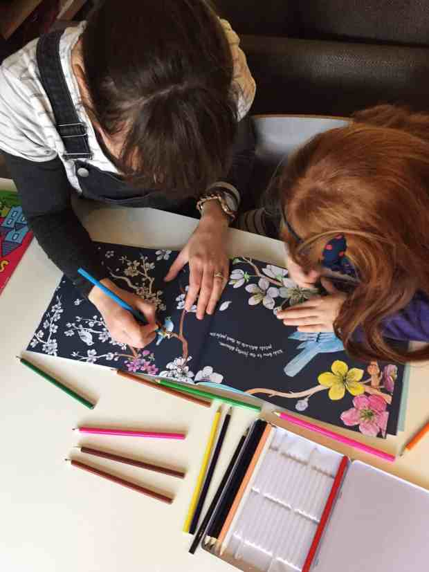 Deep in concentration colouring in our Colour Together book