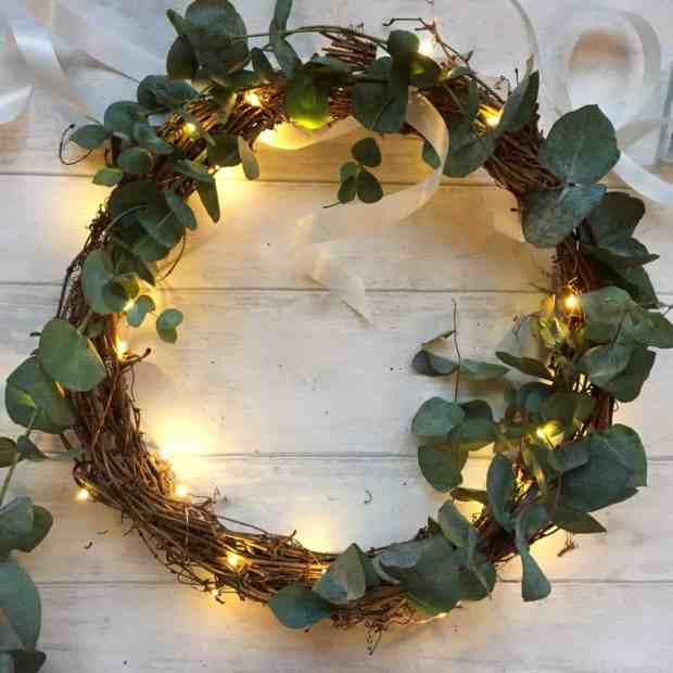 Adding eucalyptus to a simple Christmas wreath