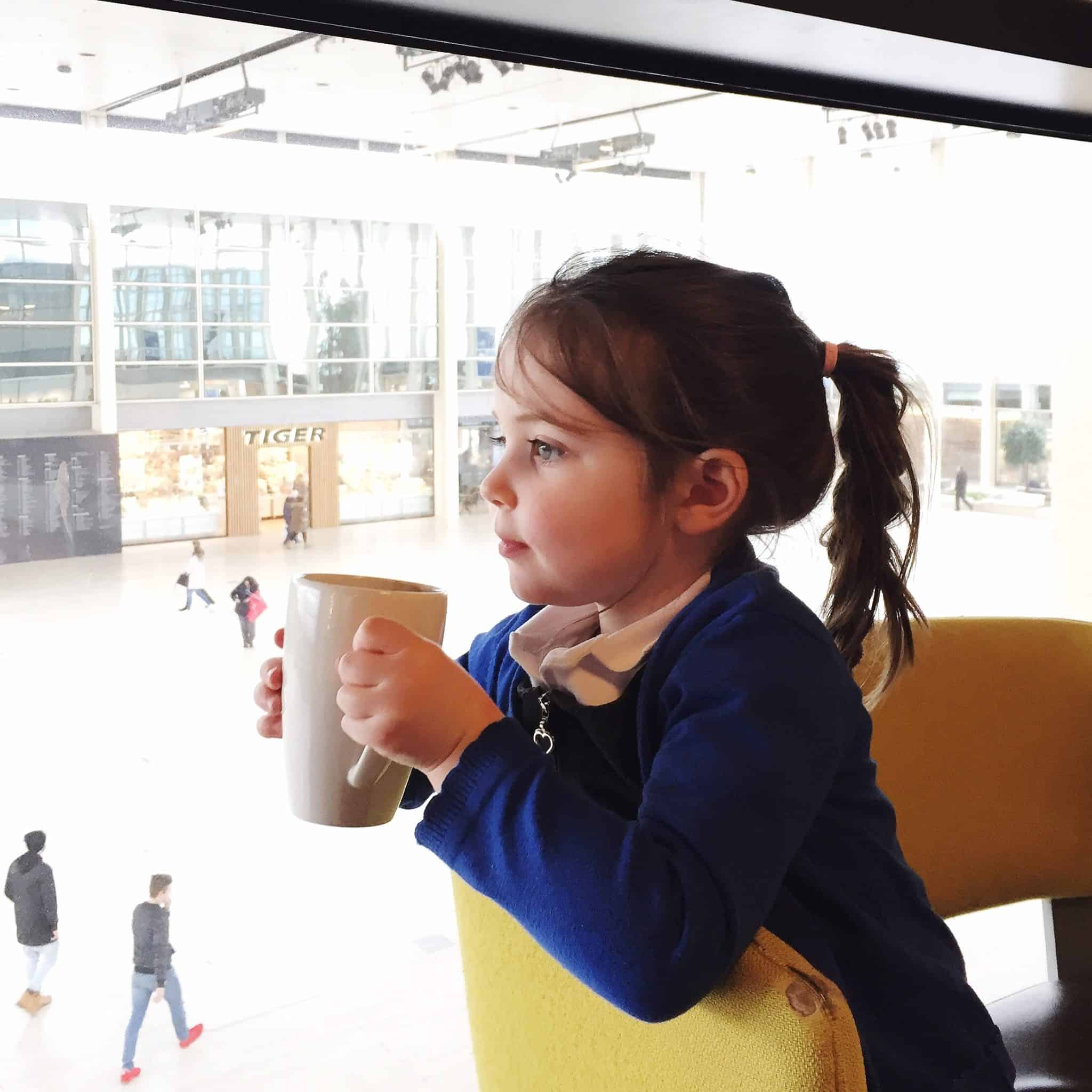 Thea drinking hot chocolate