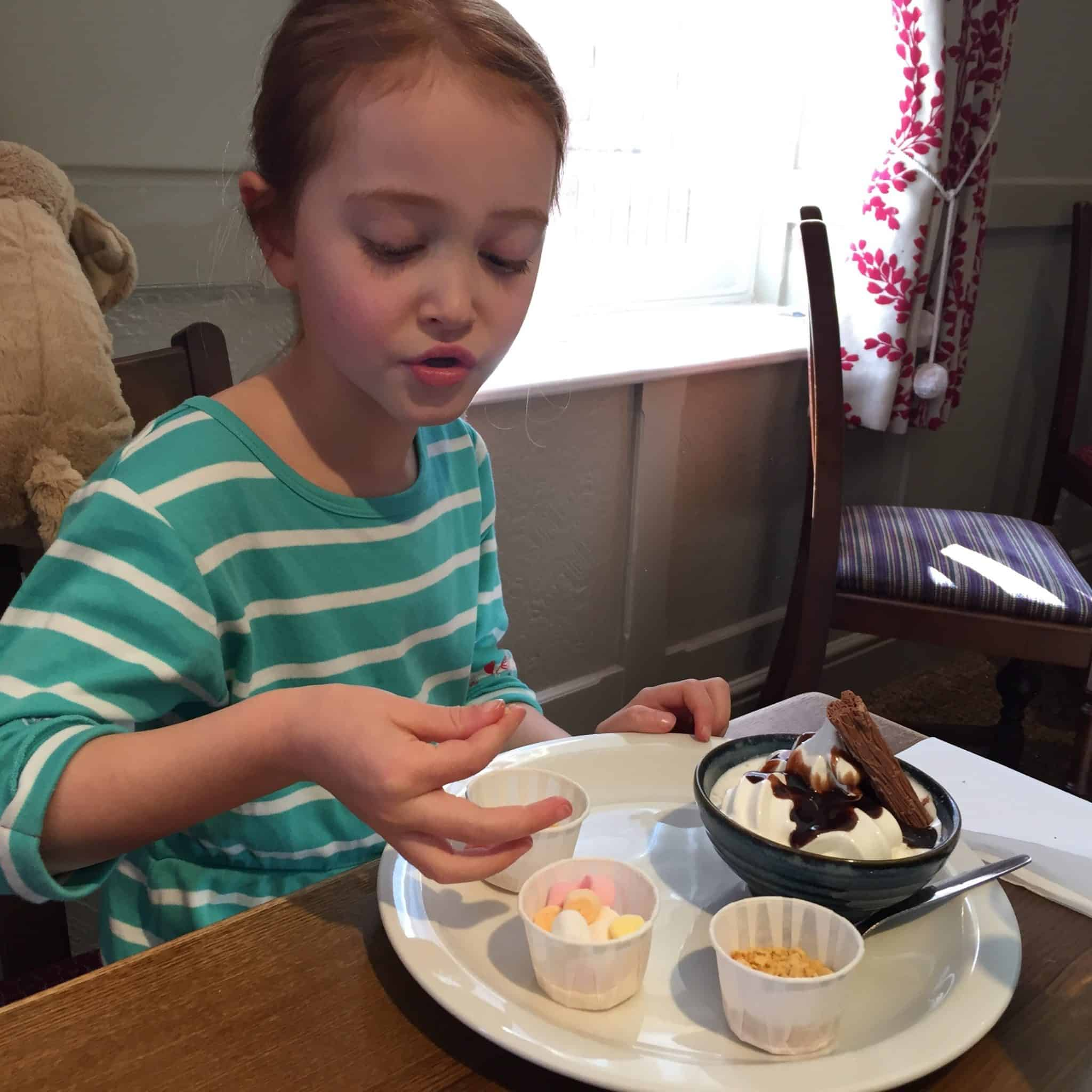 Ava enjoying her dessert at Toby Carvery Northampton