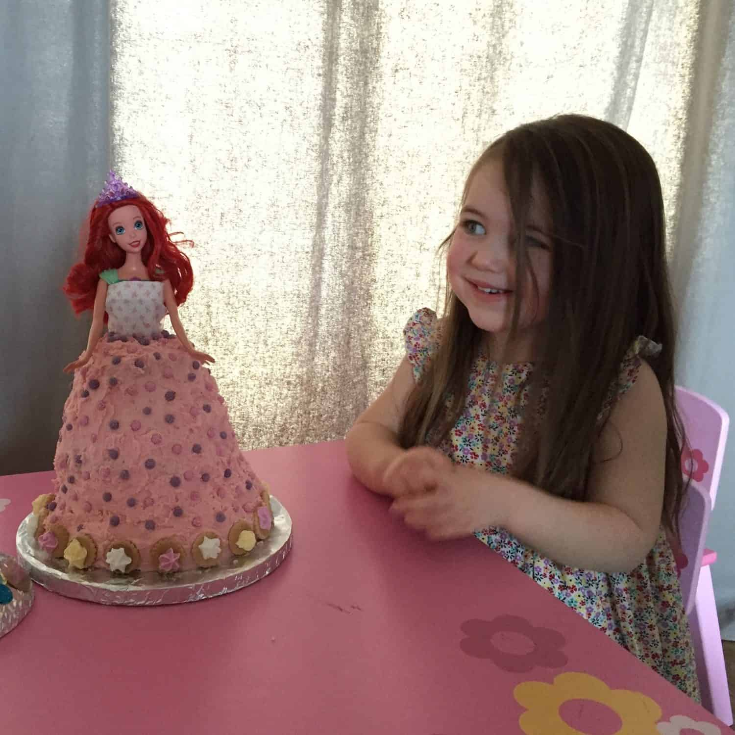 Thea on her 3rd birthday with her Little Mermaid cake