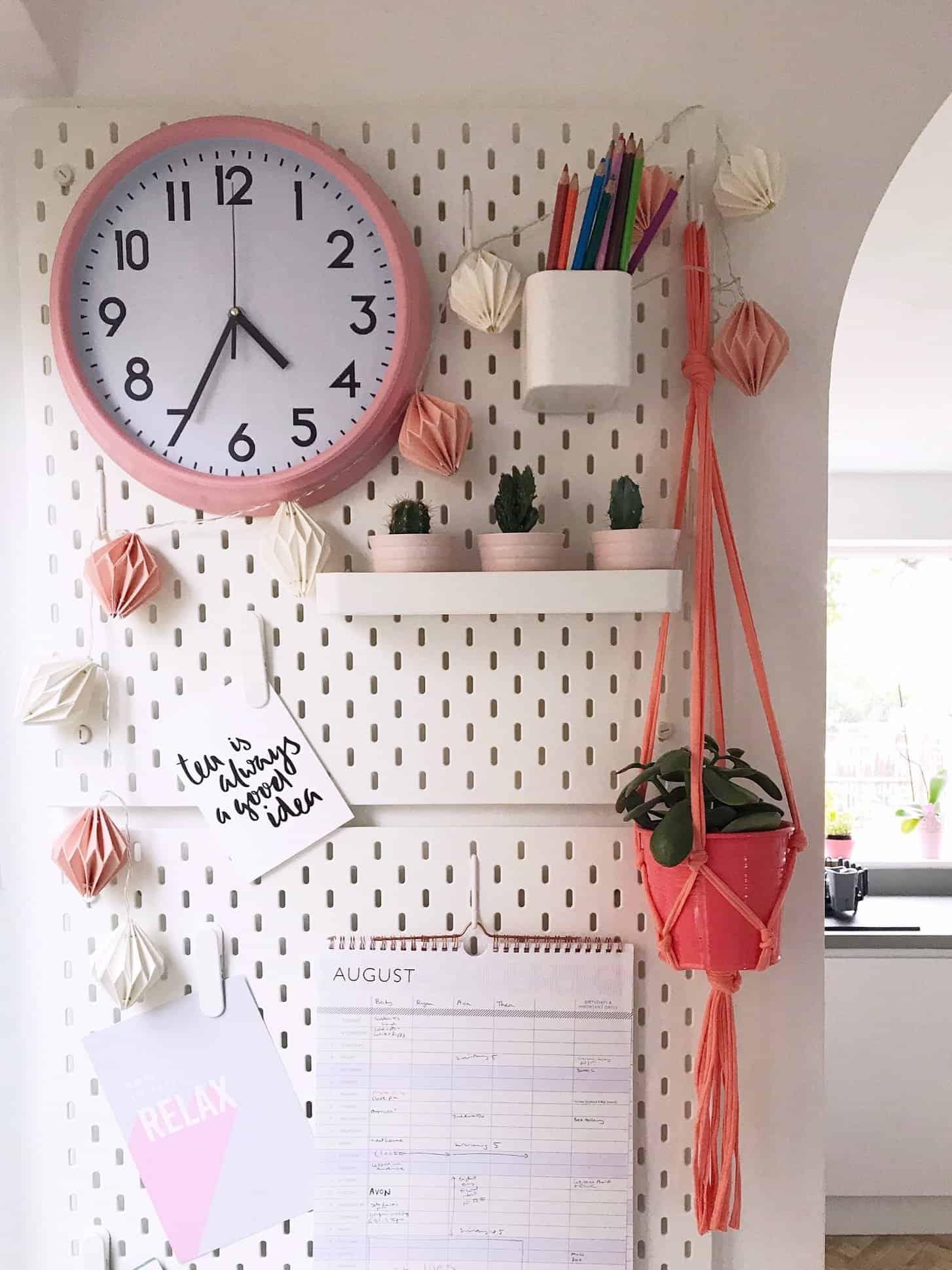 White IEKA Peg Board with Coral Pink Macrame Plant Hanger