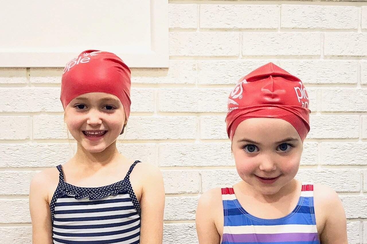 Ava and Thea in swimming caps
