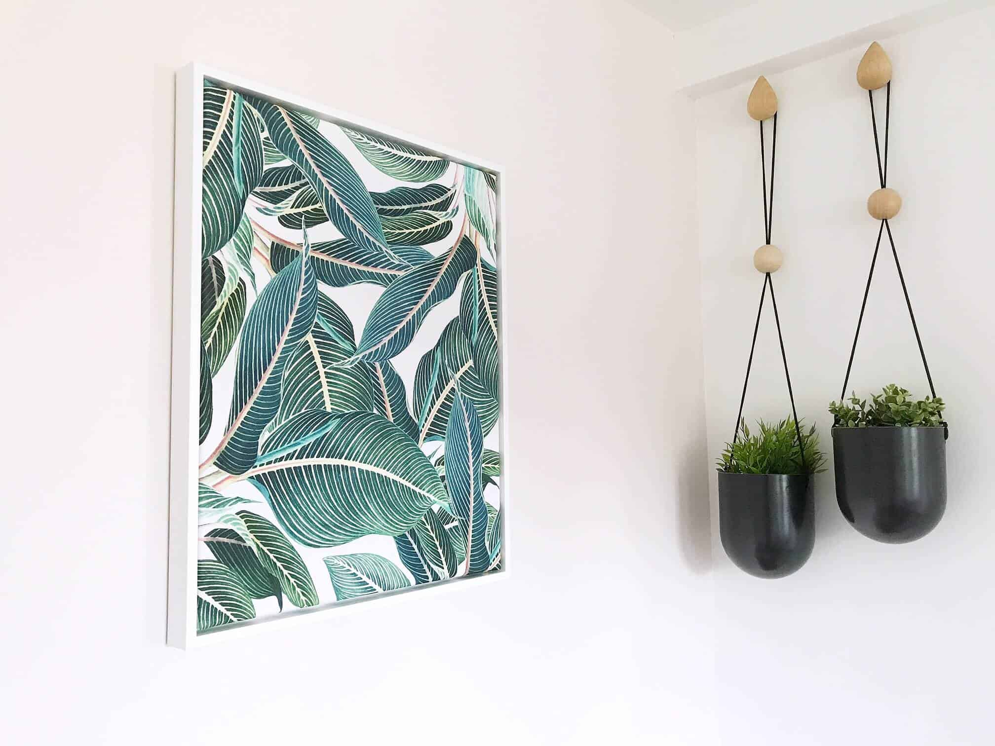 Tropical botanical leaves canvas print in a white frame