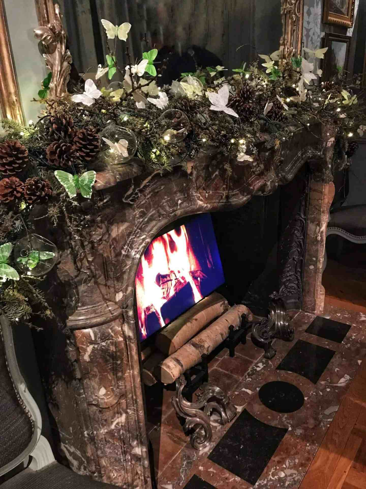 Cosy decorated fireplace at Waddesdon Manor at Christmas