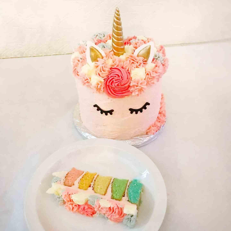Rainbow unicorn cake sliced up