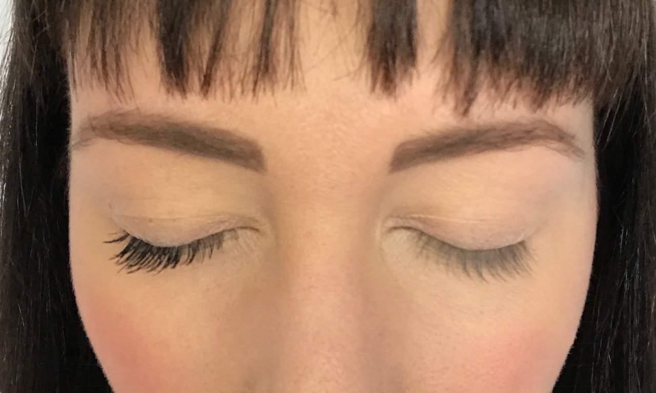 Inika Long Lash Mascara on one eye compared to bare eyelashes