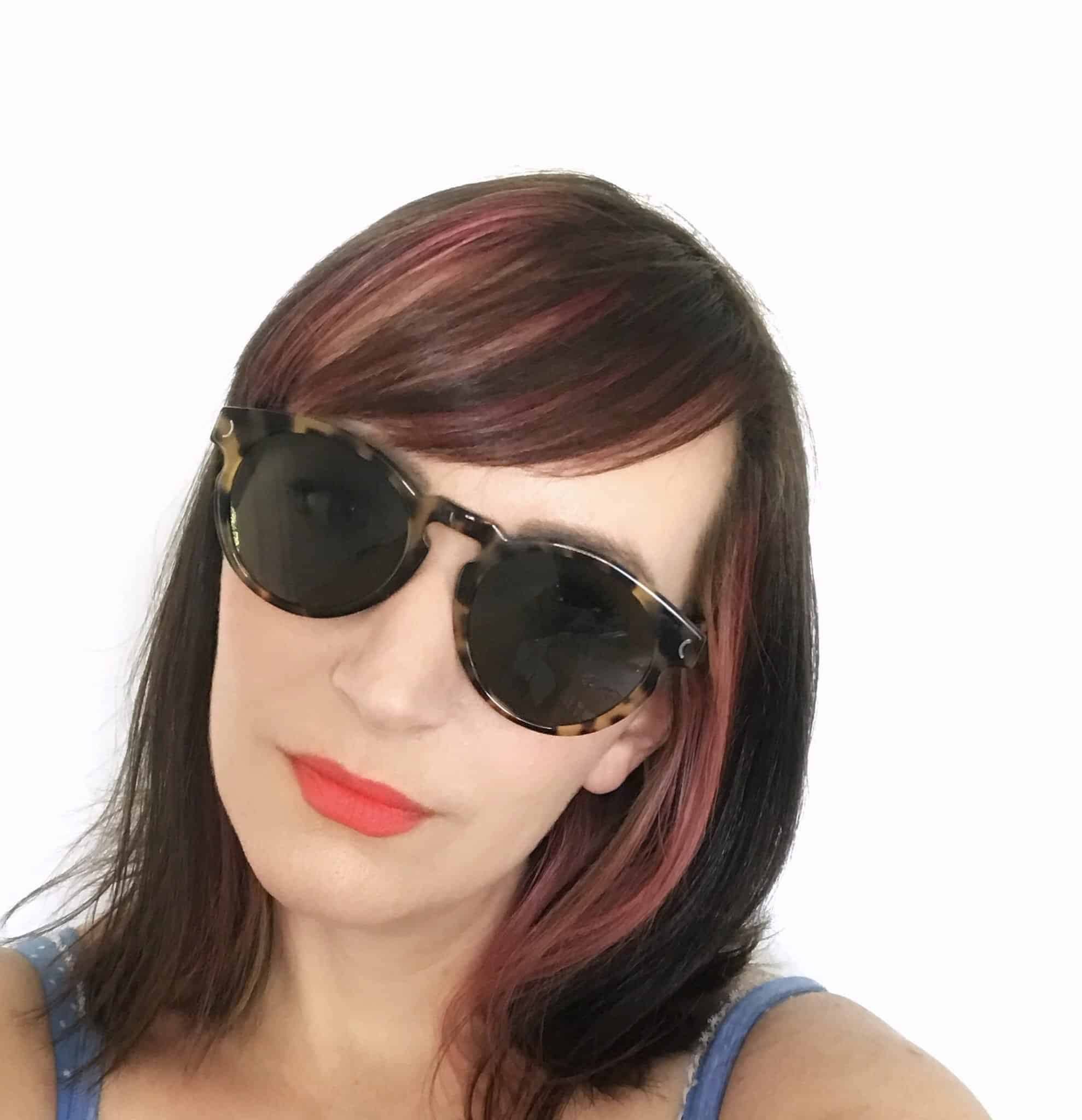 Becky Pink wearing Golden Hour sunglasses