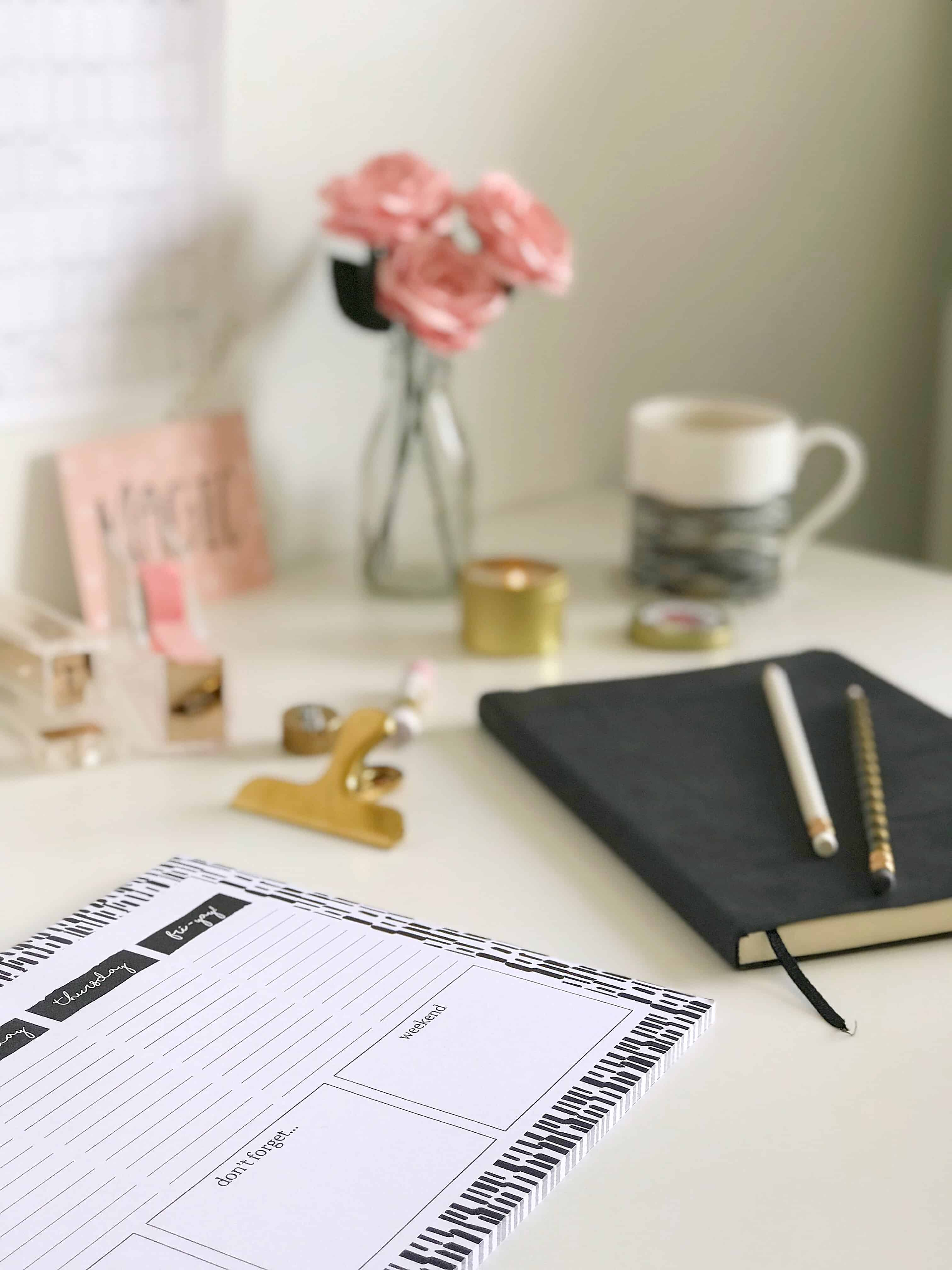 Monochrome desk planner and black notebook