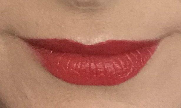 Freshly applied Hiro Lipstick in Roarr
