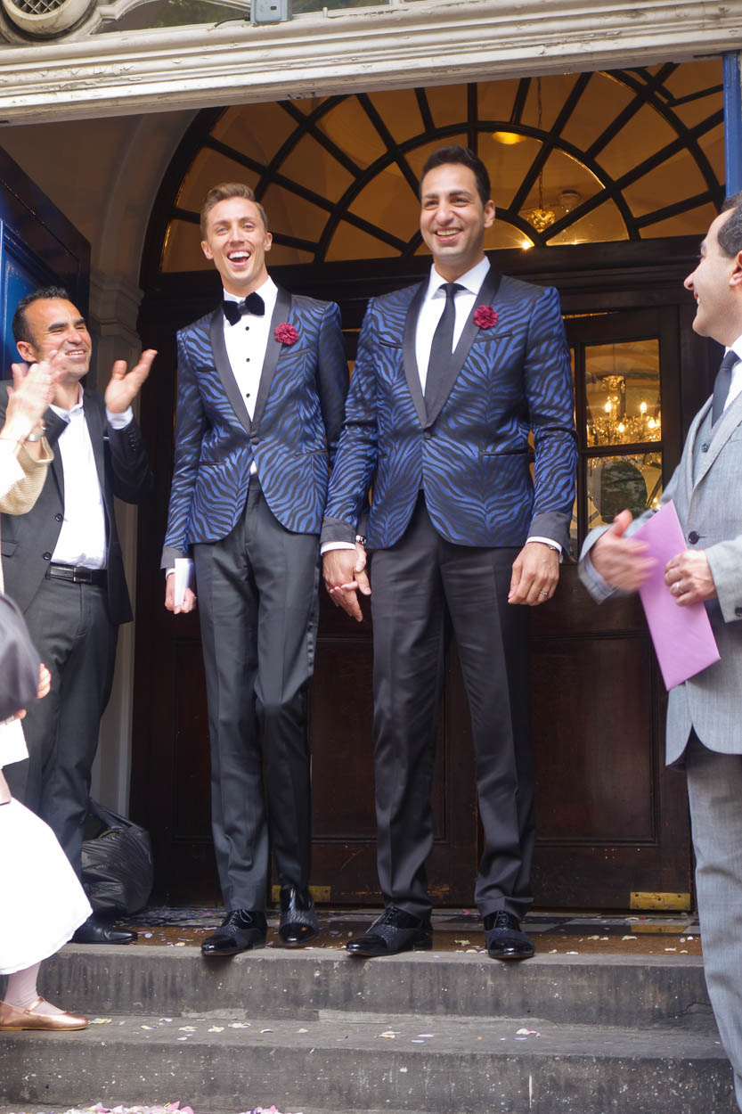 Antoine and Martin emerge from Chelsea Old Town Hall after their wedding ceremony in London