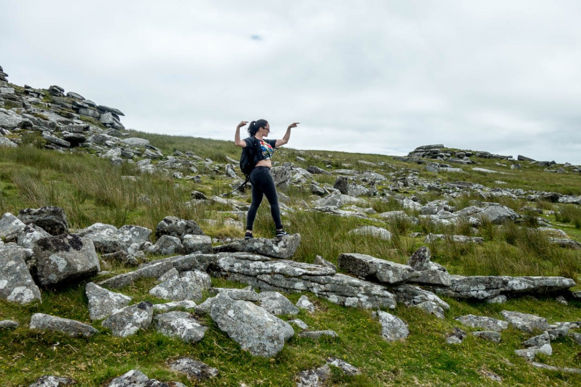 Laura shows the way to Rough Tor on Bodmin Moor, Cornwall