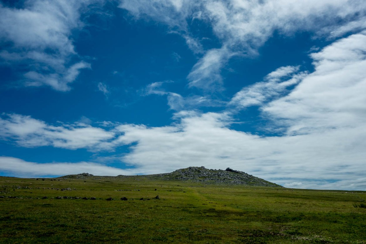 Clouds and blue skies over Rough Tor on Bodmin Moor, Cornwall