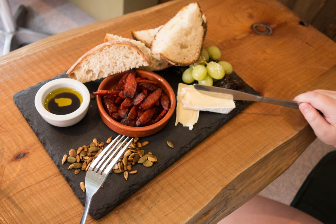 Platter of baked chorizo, sourdough bread, brie, chutney and spicy seeds at The Shed in Wadebridge, Cornwall