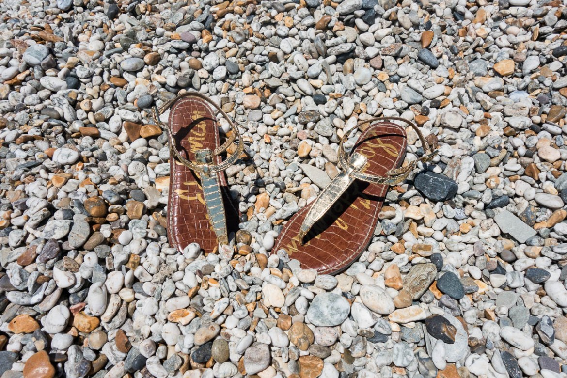 Sam Edelman Gigi sandals amongst the pebbles on Charlestown beach, Cornwall