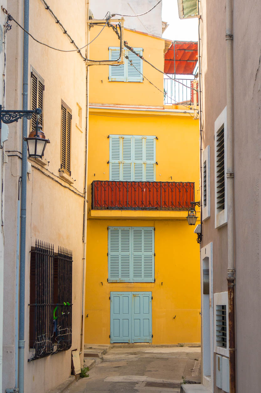 Yellow painted house with blue shutters in Antibes