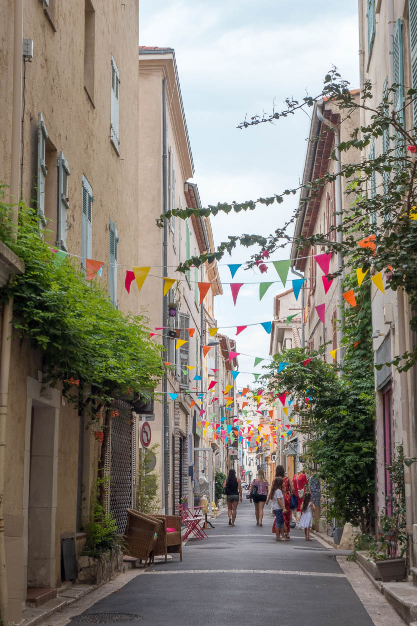 Colourful flags above the streets of Antibes
