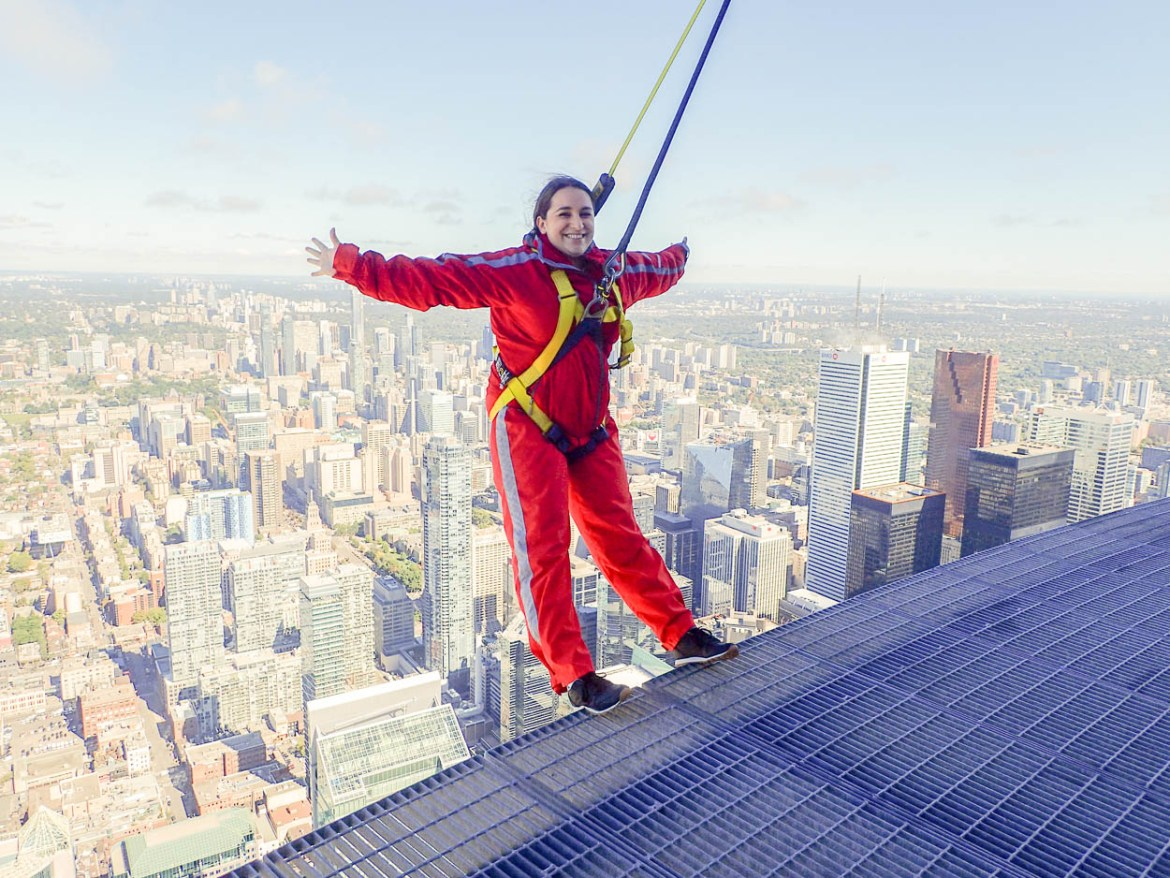 pinkschmink leaning back over Toronto on the EdgeWalk at the CN Tower