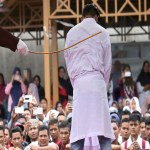 2 men in Indonesia caned dozens of times.