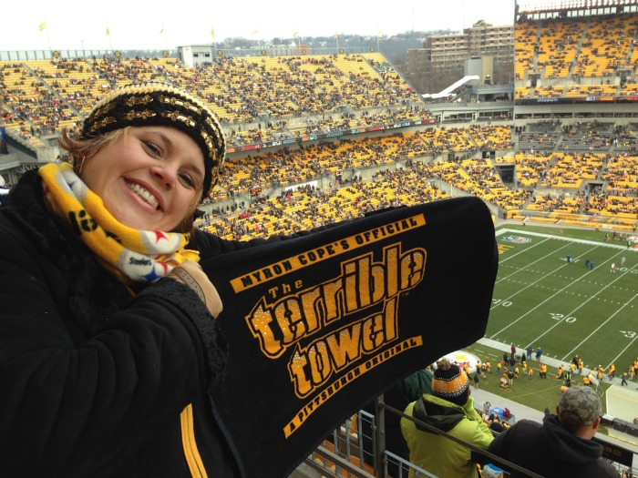 sandy at steeler game with hat and towel