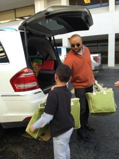 Brendon Riley & Junior Ambassador delivering BARB'S BAGs at BAG IT-Houston