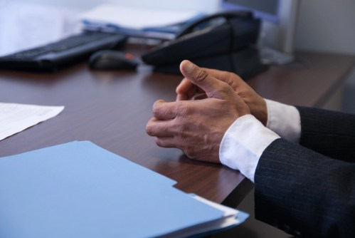 upclose of professional's hands during interview