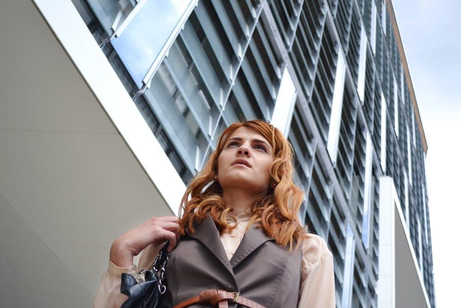 professional woman walking looking contemplative