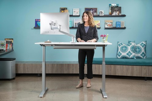 woman at a standing desk