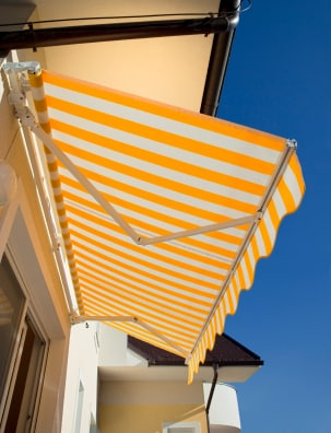 Yellow-white stripped awning.